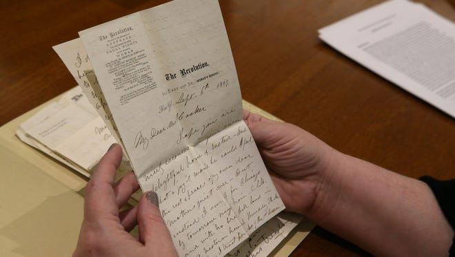 Jessica Lacher-Feldman,  assistant dean for Rare Books, Special Collection and Preservation, looks over letters from Susan B. Anthony as she examines the recently acquired collection of Isabella Beecher Hooker papers, Thursday, March 30, 2017, at the University of Rochester.