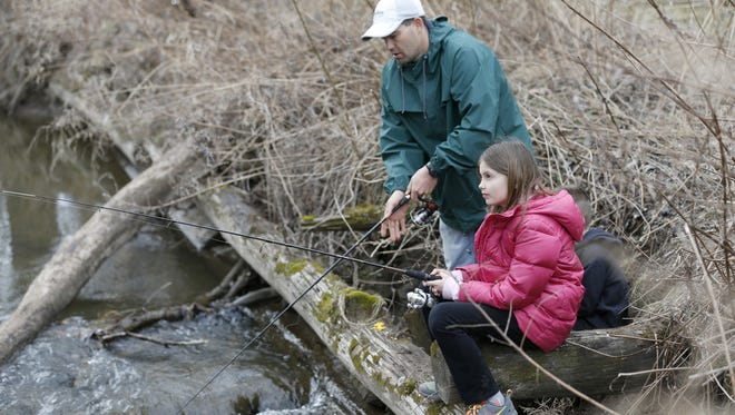 David Bradshaw of Penfield joins his daughter Alaina, 10, during the 13th annual John Riedman Foundation Opening Day Trout Derby at Irondequoit Creek in Powder Mills Park. David's son D.J. was there too.
