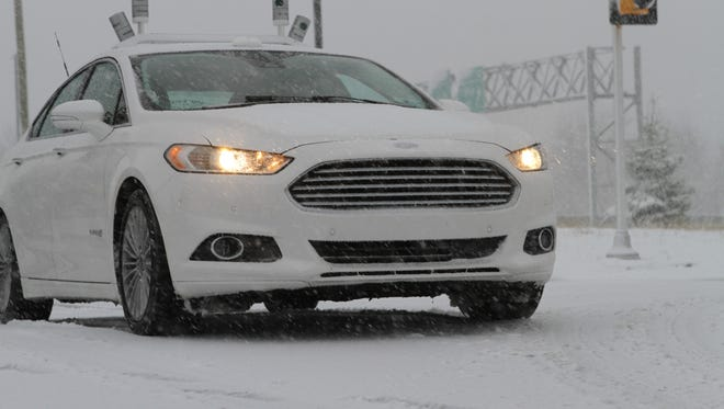 A Ford Fusion laden with self-driving sensors does some winter weather testing.
