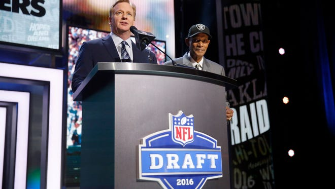 NFL Commissioner Roger Goodell introduces former NFL player Willie Brown at the 2016 draft in Chicago.