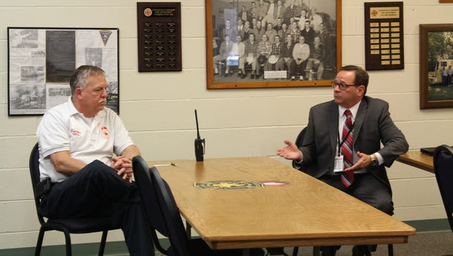Springfield Township Fire Chief Ron Henry, left, talks with Melvin House, executive director of the Ohio Department of Public Safety's Emergency Medical Services, at Springfield Township Fire Station 2 on Tuesday, April 4, 2017. Representatives from the state fire marshal and EMS offices visited the area to discuss concerns of local fire departments.