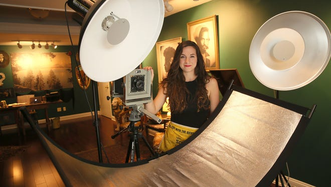 Margaret Muza is the Pfister Hotel's new artist in residence.  She created a photography studio in the hotel where she creates tintype photographs.