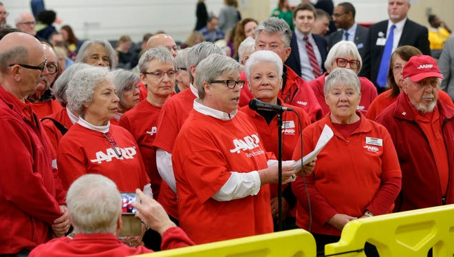 Jan Thornberg, a volunteer with AARP, is joined by fellow volunteers as she addresses state lawmakers concerning the caregiver tax credit.
