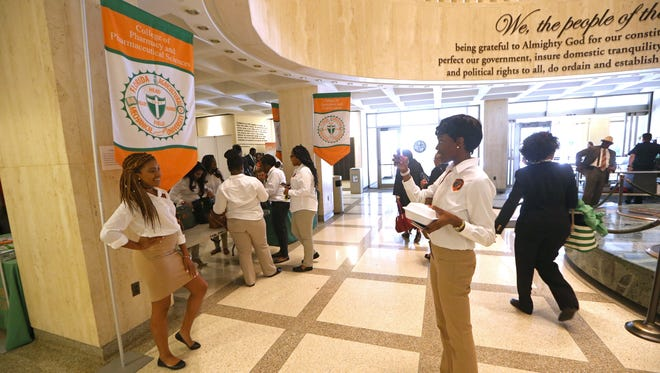 Olayemi Oladapo takes a photo of her fellow FAMU pharmacy student McKayla Bowman at the display table for FAMU Day at the Capitol on Thursday, April 6, 2017.