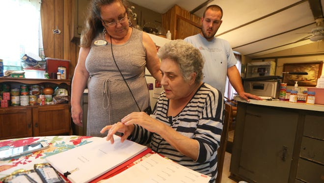 """Karen French, center, who has stage 4 lung cancer, talks about the work she continues to do to contribute to the community, from the home where she is in hospice care. """"I might be dying but I can still serve the lord… tell people God loves them,"""" said French who is surrounded by her sister, Stephanie Taylor and son Joshua French."""