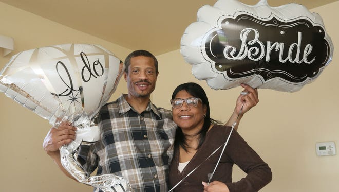 Robert Walton and Jackie Love show off wedding balloons in anticipation of their big day Sunday.