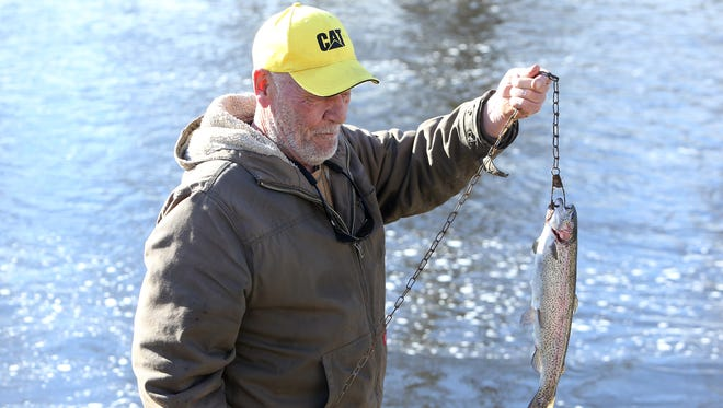 Bob Sharp of Rockaway shows off his 2 pound trout caught as anglers on the first day of New Jersey trout fish in the Rockaway River. April 8, 2017, in Rockaway.