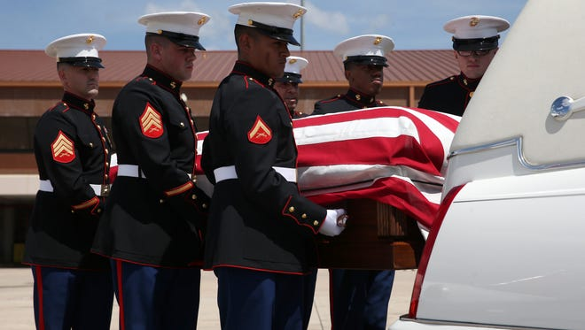 Military Honors Marines carry the remains of James Whitehurst, a fellow marine who died in combat during WWII on Nov. 20, 1943. Tallahassee International Airport was the final flight destination for Whitehurst's repatriation, which then was led by Patriot Guard Riders and law enforcement agencies on a return to his final resting place in Dothan, Alabama.