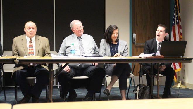 From left: Mansfield Law Director John Spon and Richland County Commissioners Darrell Banks, Marilyn John and Tony Vero discuss issues relating to animal control in the city on Thursday, April 13, 2017. The discussion was part of a community meeting meant to brainstorm solutions for the city's animal enforcement issues.