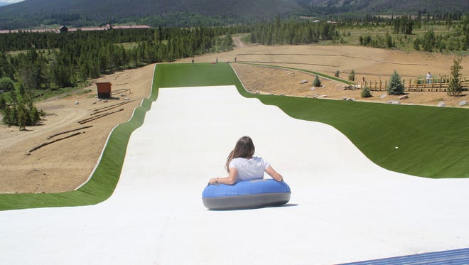 A synthetic snow tubing hill at Snow Mountain Ranch in Colorado.