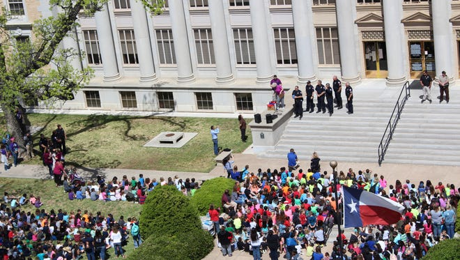 More than 1,200 children from 15 area schools were present during Tom Green County Library's 26th Annual Read to Me march on April 7.