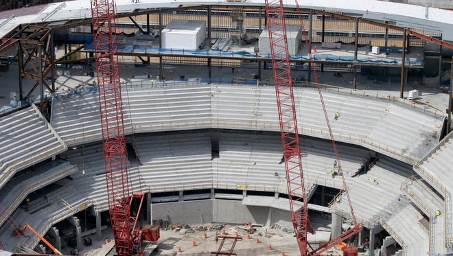 The pre-cast concrete stadia that forms the bowl is put into place piece by piece every day. About 35% of the seating bowl is complete.