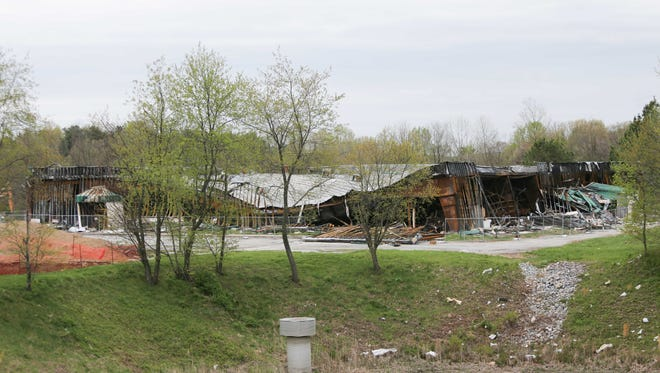 The former site of the Pike Creek Bowling Center and Charcoal Pit burned down more than a month ago.