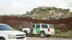 U.S. Customs and Border Protection officers patrol the border fence in Nogales, Arizona.