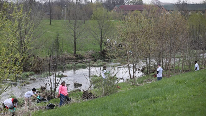 Volunteers remove trash and debris from Lincoln Creek in Milwaukee during Milwaukee Riverkeeper's 2017 Spring Cleanup.
