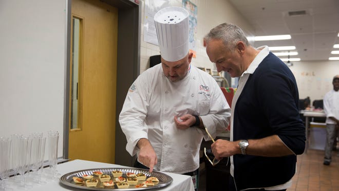 Three-star Michelin rated chef Christian Le Squer smiles as he speaks with Immokalee Technical College's head chef Peter Sullivan, left, Friday, April 21, 2017 in Immokalee. Christian Le Squer will partner with Collier County's Florida Culinary Accelerator at Immokalee to boost food entrepreneurship in the region and help put Immokalee on the map as a food-manufacturing destination for aspiring chefs.