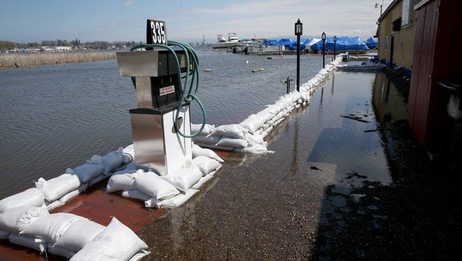 Rising lake waters have flooded Arney's Marina in Sodus Point. Without places to dock and with dangerous debris in the water, even recreational boating and fishing are taking a hit.
