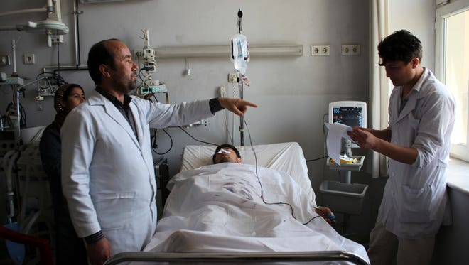 An injured soldier recovers in a hospital after Friday's attack at a military compound in Mazar-e-Sharif province north of Kabul, Afghanistan, Saturday, April 22, 2017.  Gunmen wearing army uniforms stormed a military compound in the Balkh province, killing at least eight soldiers and wounding 11 others, an Afghan government official said Friday. (AP Photo) ORG XMIT: XRG102