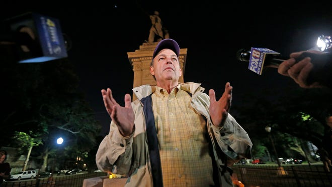Pierre McGraw, head of a group called the Monumental Task Committee, speaks during a candlelight vigil at the statue of Jefferson Davis in New Orleans, Monday, April 24, 2017. New Orleans will begin taking down Confederate statutes, becoming the latest Southern body to divorce itself from what some say are symbols of racism and intolerance. (AP Photo/Gerald Herbert)