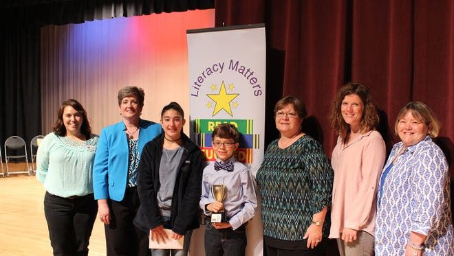 Ethan Keenan from Thurman Francis Arts Academy, center, won the 2017 Reed to Bee organized by Read To Succeed. Pictured from left, are Malia Grubbs, RTS; Martha Touchton, pronouncer; Alyssa Perez, first runner-up (Cason Lane Academy); Ethan Kennan; and judges Diane Mackey, Janie Becker and Suzy Willis.