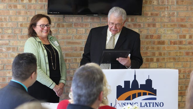 Dr. Linda Peterson, MD, FAPA, FAPM, Chief Medical Officer at McLaren Greater Lansing, is honored by the Lansing Latino Health Alliance for her contributions to the Lansing Community with the Distinguished Achievement Award.