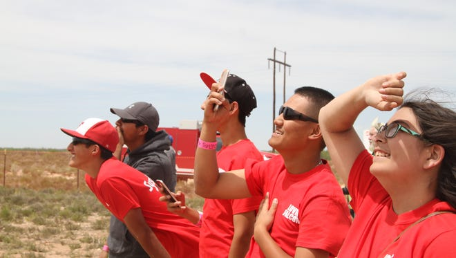 Loving High School students watch as one of their rockets launch on Thursday for the Discovery Education Systems Go New Mexico. Six high schools in southeastern New Mexico participated in the program.