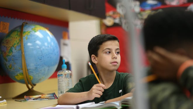 Mouiad Alhendi, 10, sits in his 4th-grade reading comprehension class with teacher Sylvia Redding at Astoria Park Elementary School on Wednesday, March 22, 2017.