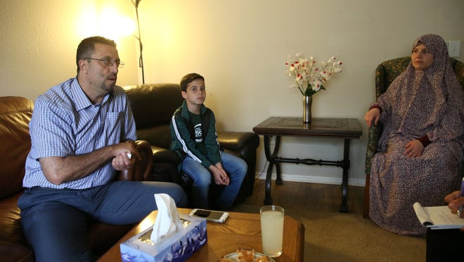 Safouh Alhendi sits in the living room of his home in Tallahassee with his wife Emein and their son Mouiad Alhendi, 10, on Tuesday, March 14, 2017.