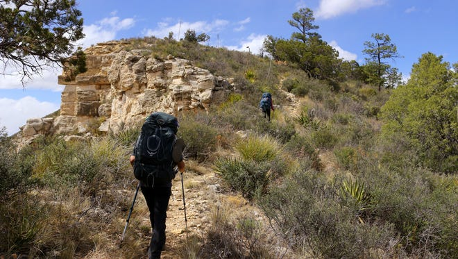 Hikers from the Colorado Mountain Club and Highpointers Club hike in the Guadalupe Mountains during a test run of the Guadalupe Ridge Trail in April 2016.