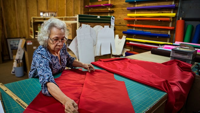 "Sophia Goff, 69, works on cutting out a jockey silk inside the workspace at Becker and Durski Turf Goods on South Fourth Street. Goff first began making silks in the 1980s when her mother, a waitress at Wagner's Pharmacy, introduced her to owner Lee Wagner. ""They really haven't changed that much in all the years,"" Goff said. ""In the beginning we used more satin material, then nylon. Now, it's lycra."" Throughout the years, Goff has made silks for Derby winners such as Secretariat and Seattle Slew, along with other prestigous horses from Calumet Farm. ""The reason I've done this for so long is that it's challenging,"" Goff said. ""People bring a picture and it's up to me to make it, cut it out, and satisfy the customer. It's tedious, but it's satisfying.""April 28, 2017"
