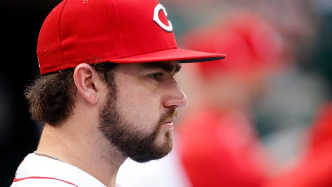 Cincinnati Reds starting pitcher Brandon Finnegan (29) sits in the dugout during the interleague baseball game between the New York Yankees and the Cincinnati Reds, Monday, May 8, 2017, at Great American Ball Park in Cincinnati.
