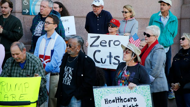 City residents and community leaders protest the proposed, across-the-board 10 percent cut to the city's budget, including the health department's, Monday, May 8, 2017, at Cincinnati City Hall.