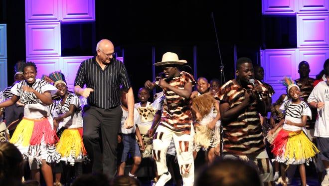 Dr. Wayne Smith, Master's Head of School,.with the Imani Choir.