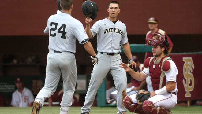 Wake Forest's Stuart Fairchild congratulates Gavin Sheets on his home run during their game at Dick Howser Stadium on Friday, May 12, 2017.