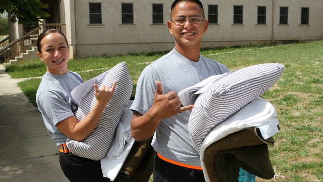Guam Army National Guardsmen Spc. Nicole D. Cruz, left, and Sgt. Jacob T. Penaflor receive supplies May 15 after reporting for the National Guard Bureau's Region 7 Best Warrior Competition May 15 at San Luis Obispo, California.