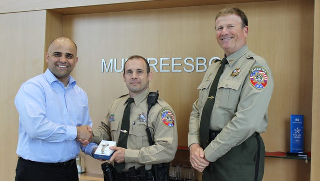 General Manager Andy Obeissy of Ford of Murfreesboro presents a watch to Officer of the Month, Patrol Deputy Scott Daniel. At right is Patrol Capt. Rhett Rankin.