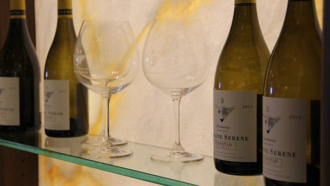 Domaine Serene displays its 2014 Evenstad Reserve Chardonnay in the check-in area. The wine was named the best white wine in the world on the 2016 Wine Spectator Top 100.