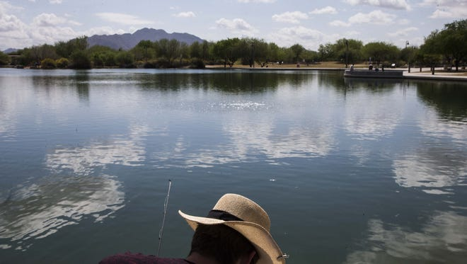 Curtis Rauen fishing at Veterans Oasis Park in Chandler on March 23, 2017.  The Arizona Game & Fish Department's release catfish at the lake.