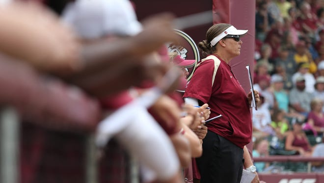 FSU Head coach Lonni Alameda watches her team from the dugout against Georgia during the Seminoles 8-5 win at JoAnne Graf Field on Sunday, May 21, 2017.