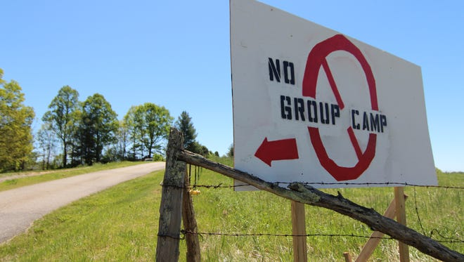 A sign expresses opposition to the campground development beside Windswept Ridge Road and the eight-foot right of way at the center of the Planning Board's decision.