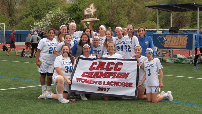 Georgian Court women's lacrosse celebrating the CACC title.