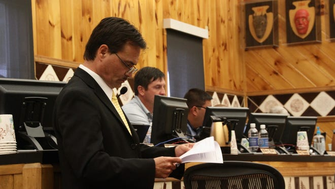Principal Chief of the Eastern Band of Cherokee Indians Patrick Lambert reads through two articles of impeachment that have been drafted against him at his impeachment hearing Tuesday May 23, 2017.