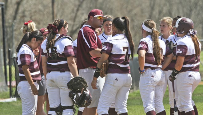 Lyon (center), who makes less than at least two assistant coaches in the Sun Belt, led ULM to its second 30-win season in three years and first postseason appearance since 1997.