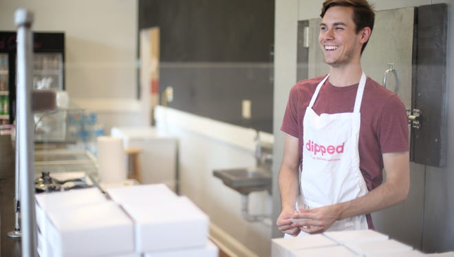 Alex James, who started Dipped, a chocolate dessert delivery service, last year out of his friend's workspace on West Pensacola Street will celebrate his one-year anniversary this June.