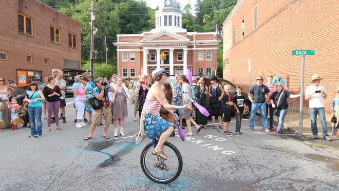 A juggling unicyclist, seen here at the 2016 event, is just one of the unexpected oddities that could be on offer at the 10th anniversary Mermaid Parade June 3.