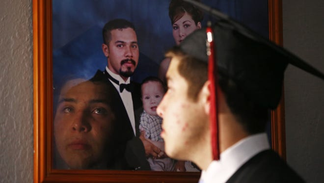 Marco Coss prepares to graduate from Red Mountain High School on May 25, 2017, in Mesa. His dad, Marco Tulio Coss-Ponce (pictured in family photo) won't be there; he was arrested and deported on May 11, 2017, by ICE officials under President Trump's new deportation policies.