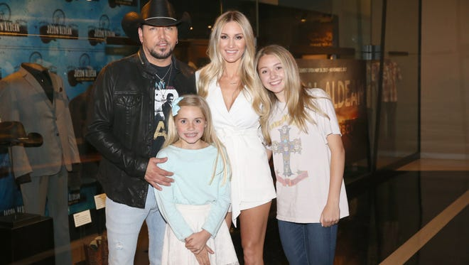 NASHVILLE, TN - MAY 25:  Singer-songwriter Jason Aldean and family at the Country Music Hall of Fame and Museum Celebrates Opening of Jason Aldean Exhibit on May 25, 2017 in Nashville, Tennessee.  (Photo by Terry Wyatt/Getty Images for Country Music Hall Of Fame & Museum) *** Local Caption *** Jason Aldean