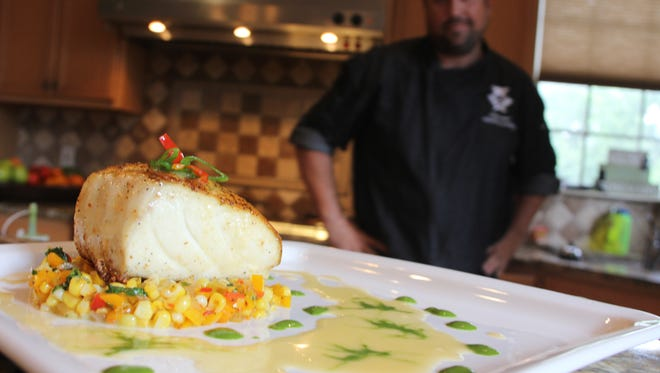 Josh Cooper's seared Chilean sea bass over a corn-and-pepper salad and a shallot buerre blanc sauce, drizzled with a final touch of cilantro-lime oil.