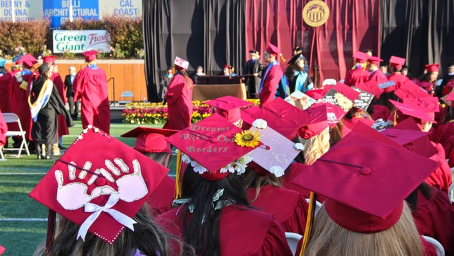 Students hats - 2017 Hartnell College Graduation