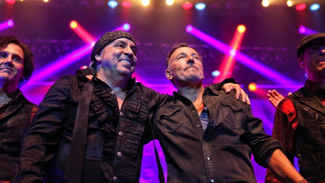 Bruce Springsteen, right, performs at the Count Basie Theatre in Red Bank, N.J., with rocker Steven Van Zandt.